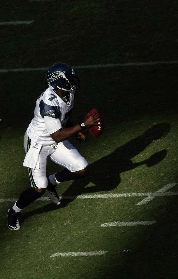 Quarterback Tarvaris Jackson #7 of  the Seattle Seahawks rolls back in the pocket against  the San Diego Chargers during their  NFL preseason game at Qualcomm Stadium. Photo: Donald Miralle, Getty Images / 2011 Getty Images