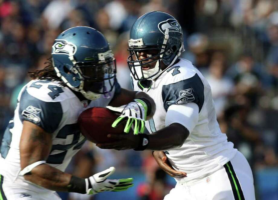 Quarterback Tarvaris Jackson #7 of  the Seattle Seahawks gives the ball to teammate runningback Marshawn Lynch #24 against the San Diego Chargers during their  NFL preseason game on August 11, 2011 at Qualcomm Stadium in San Diego, California. Photo: Donald Miralle, Getty Images / 2011 Getty Images
