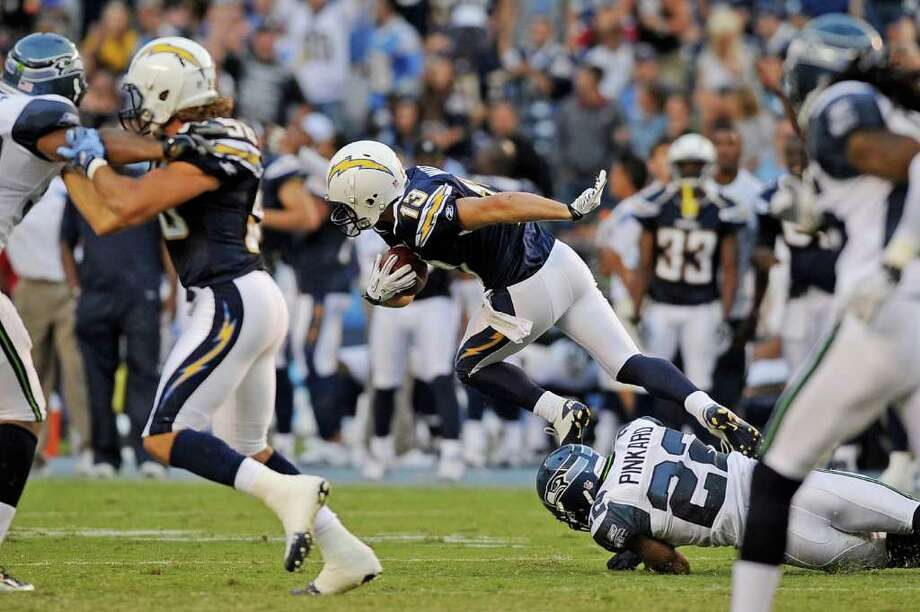 Bryan Walters #13 of the San Diego Chargers eludes a tackle by Jacob Hester #22 of the San Diego Chargers as he returns a kick for a 103-yard tiuchdwon. Photo: Kevork Djansezian, Getty Images / 2011 Getty Images