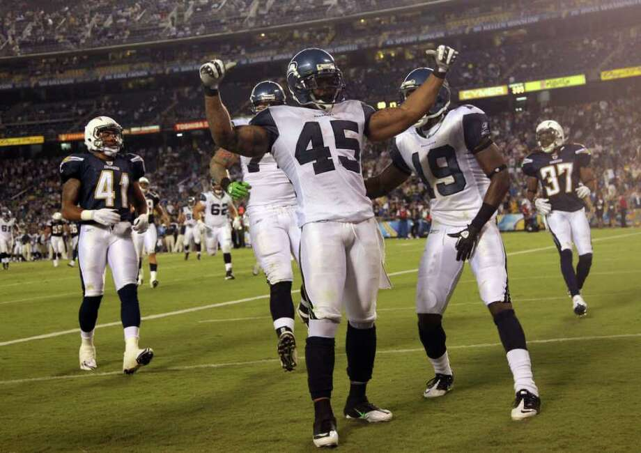 Thomas Clayton #45 of the Seattle Seahawks celebrates the winning touchdown late in the 4th quarter against the San Diego Chargers. Photo: Donald Miralle, Getty Images / 2011 Getty Images