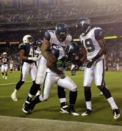 San Diego Chargers Cap Space: Thomas Clayton #45 Of The Seattle Seahawks Celebrates The