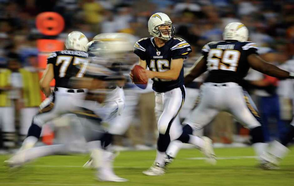 Quaterback Scott Tolzien #16 the San Diego Chargers drops back against the Seattle Seahawks.