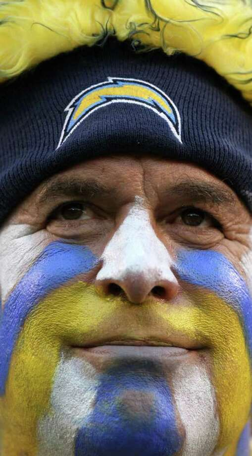 A San Diego Chargers fan looks on in dissapointment during his team's 24-17 loss against the Seattle Seahawks during their  NFL preseason game at Qualcomm Stadium. Photo: Donald Miralle, Getty Images / 2011 Getty Images