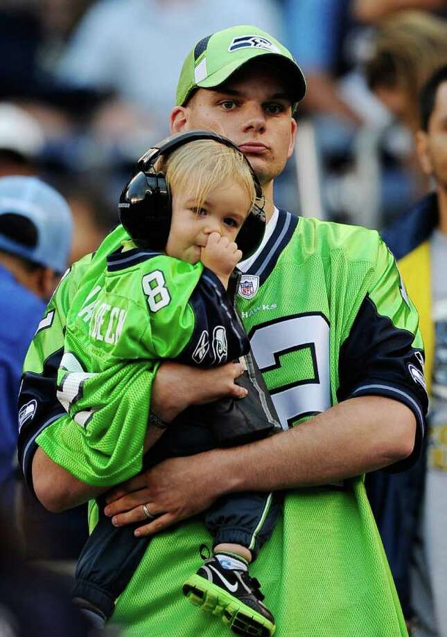 Seattle Seahawks Fans, 1-year-old Cody Coffey is held by his father Jonathan Coffey while they follow the action on the field. Cody's father is stationed at Marine Corps Base Camp Pendleton Photo: Kevork Djansezian, Getty Images / 2011 Getty Images