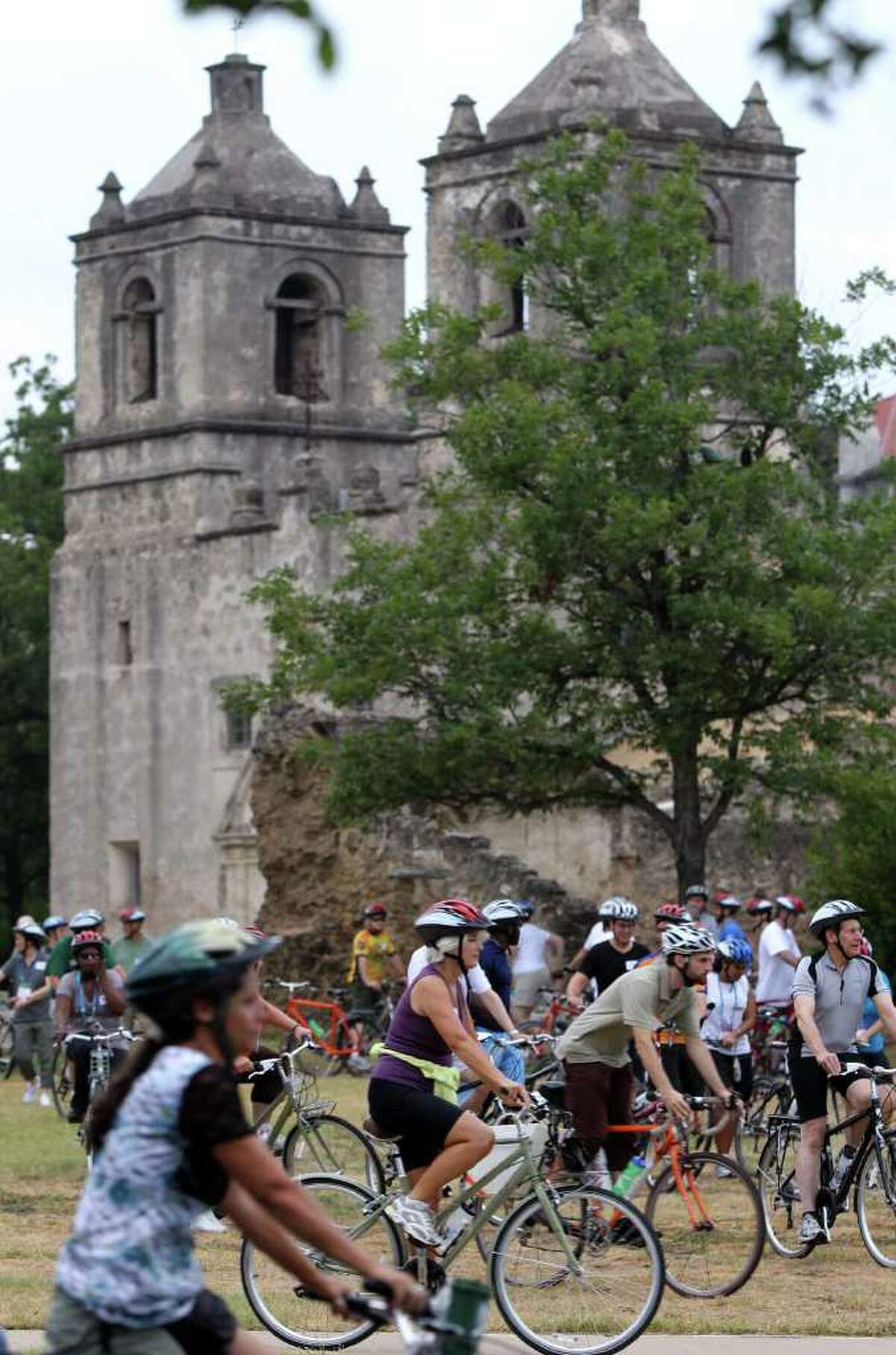 Cyclists with a group of people from the National Conference of State Legislatures leave Mission Concepción. The ride started at the Alamo and headed south on the Mission Reach of the San Antonio River. Said freshman Rep. Naomi Gonzalez, D-El Paso:
