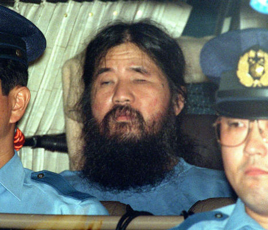 "Shoko Asahara has been in custody since his arrest in 1995 for a gas attack that killed a dozen people on a Tokyo subway. The leader of the Aum Shinrikyo cult was sentenced to death in 2004. His lawyer says he has ""prison psychosis"" and should be treated before his appeal is decided. Photo: AP Photo/Kyodo News File"