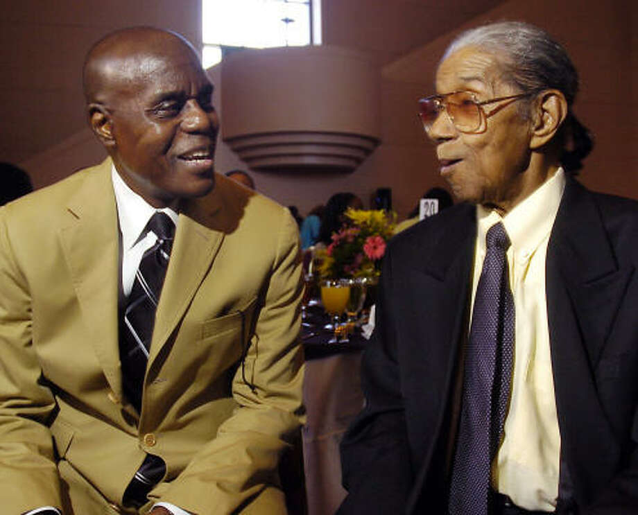 Jazz Education Inc. founder and artistic director Bubbha Thomas, left, congratulates legendary jazzman Conrad Johnson for being honored at the Mayor's Jazz Brunch. Photo: Dave Rossman, For The Chronicle