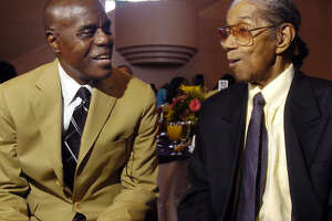 Jazz Education Inc. founder and artistic director Bubbha Thomas, left, congratulates legendary jazzman Conrad Johnson for being honored at the Mayor's Jazz Brunch.