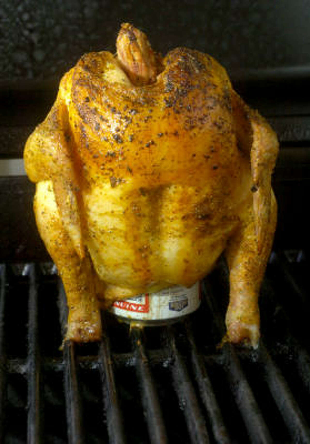 Roasting a chicken on a beer can allows for even heat distribution on all sides of the bird.