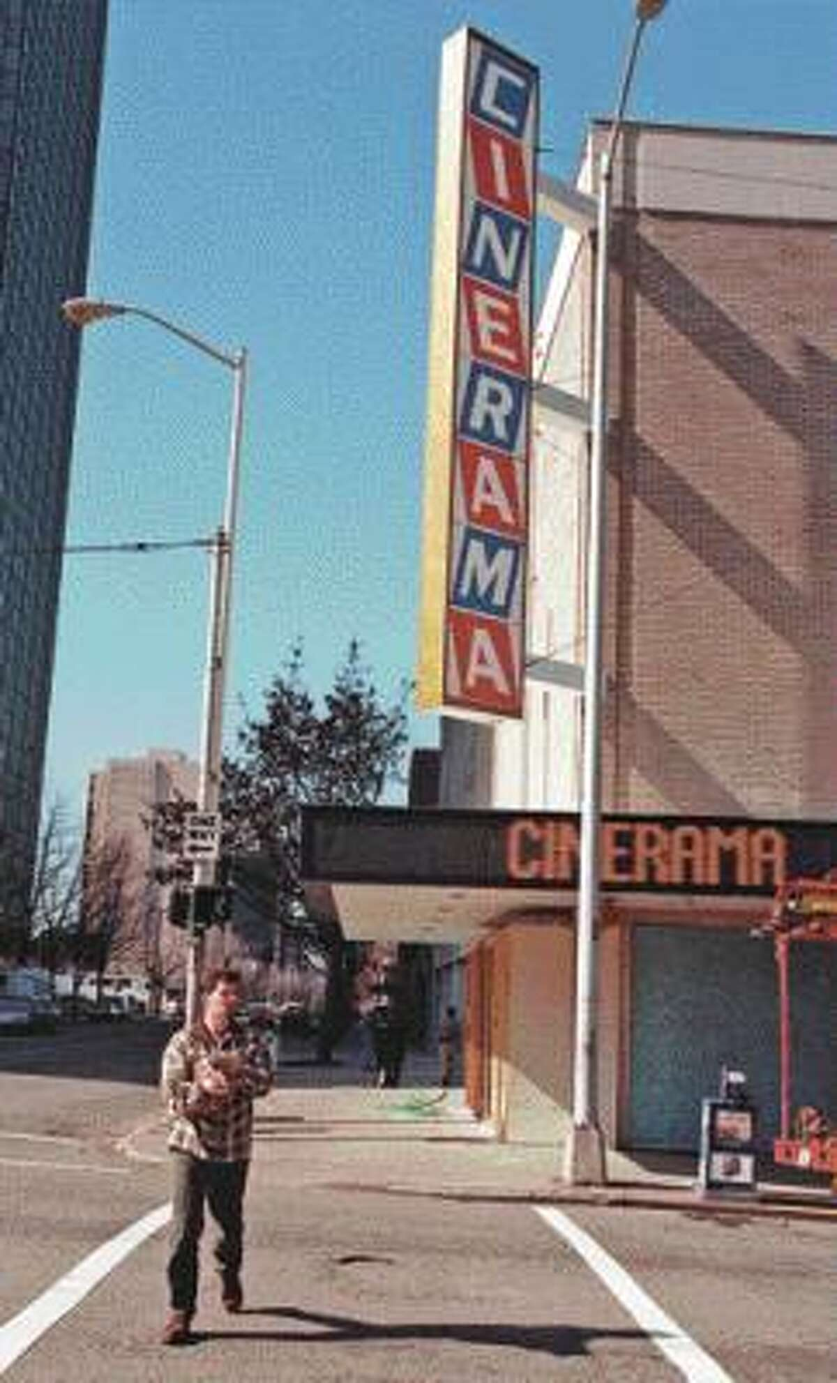 """Microsoft big shot Paul Allen used a bit of his dough to purchase Seattle's endangered Cinerama Theatre. He spruced up the theater of his childhood as a """"gift to the city."""""""