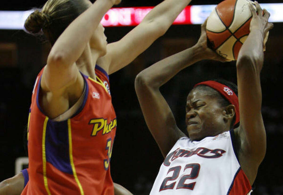 Sheryl Swoopes has her shot blocked by Jennifer Derevjanik in the second period. Swoopes finished with 30 points.