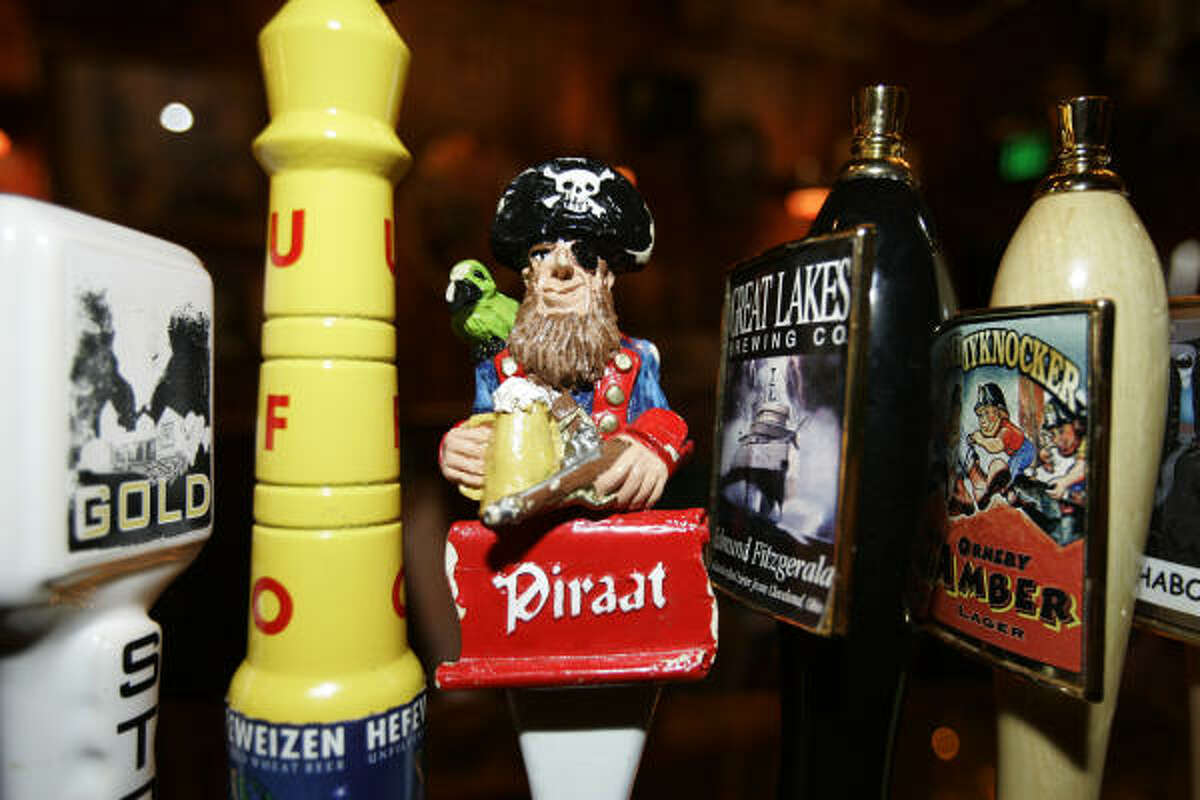A buccaneer tap handle signals Piraat Belgian strong beer at the Surly Girl Saloon in Columbus, Ohio. The microbrewery movement has brought numerous artsy and exotic handles to bars.