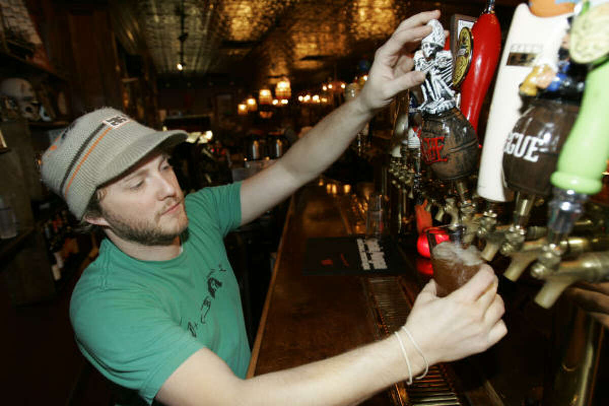 Bartender Jon Iddings fills a glass with Rogue Beer at the Surly Girl Saloon.