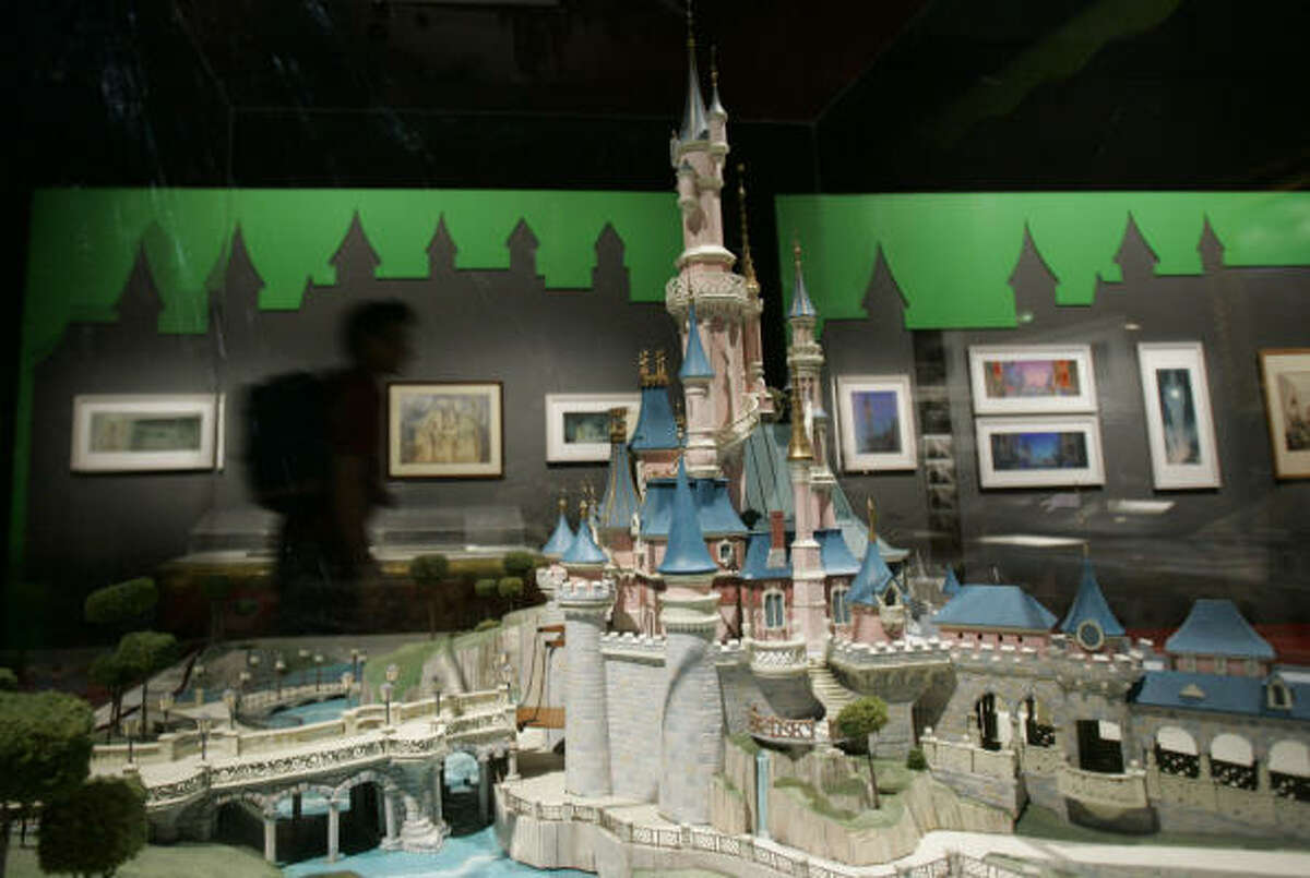 A man walks past a replica of the Sleeping Beauty castle at the Grand Palais museum in Paris. Paris' culture world seems fixated this season on paying homage to Americana, and this fascinating exhibit shows how Disney's animators took inspiration from European art — from Bavarian castles to the German Expressionist filmmakers.