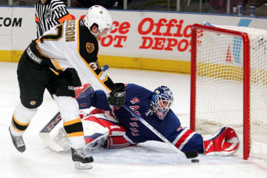 New York Rangers goalie Henrik Lundqvist, makes a save against Boston Bruins' Patrice Bergeron. Photo: MARY ALTAFFER, AP