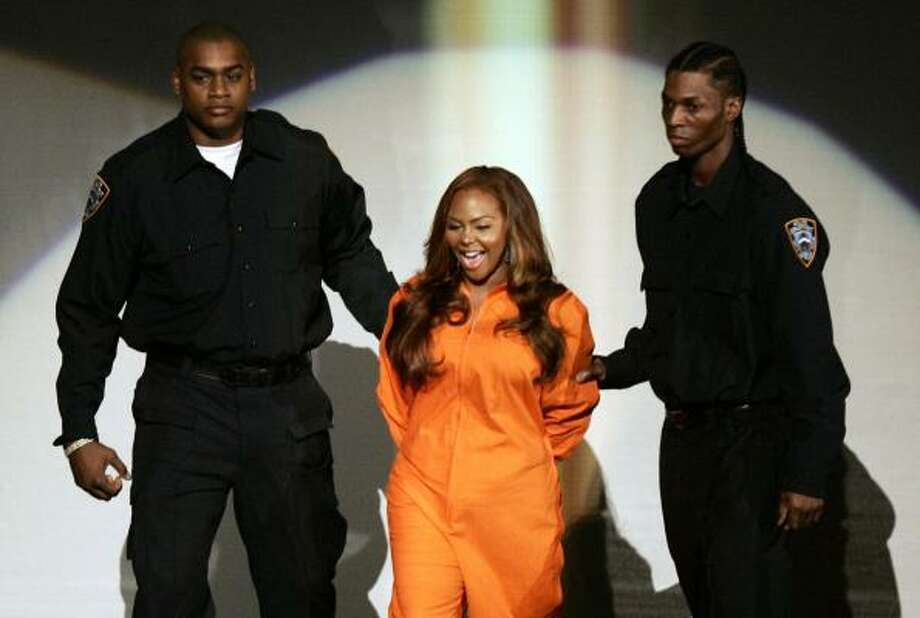Lil' Kim is escorted on stage at the Aug. 31 MTV Video Music Awards, in New York. Photo: GARY HERSHORN, REUTERS