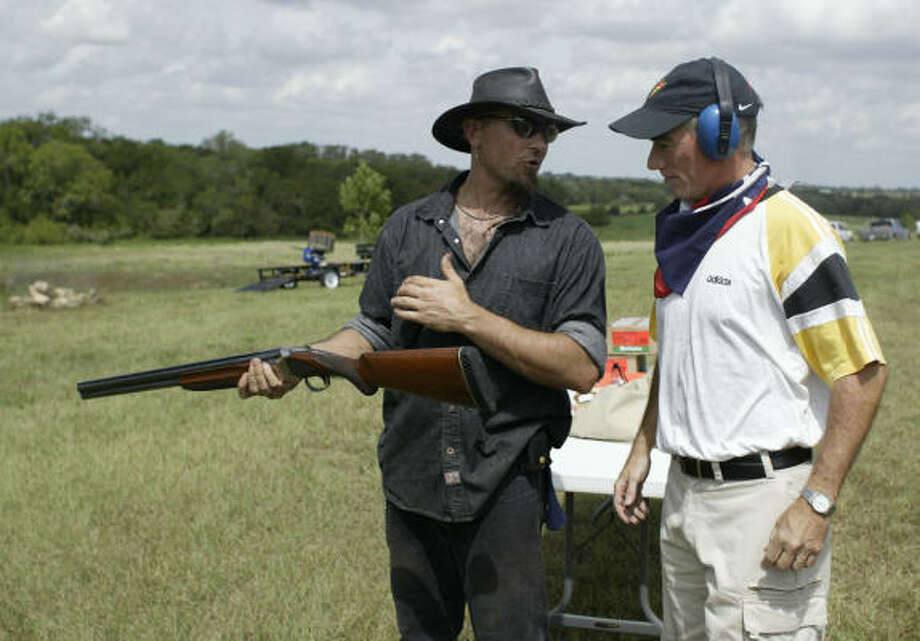 Skeet shooting guide Cowboy Szymanski, left, prepares swedish tourist Cyril Nilsson to shoot skeet with a twelve gauge shotgun at Texas Ranch Life in Chappell Hill. The ranch gives tourist the chance to experience life on a Texas ranch. Photo: Billy Smith II, CHRONICLE