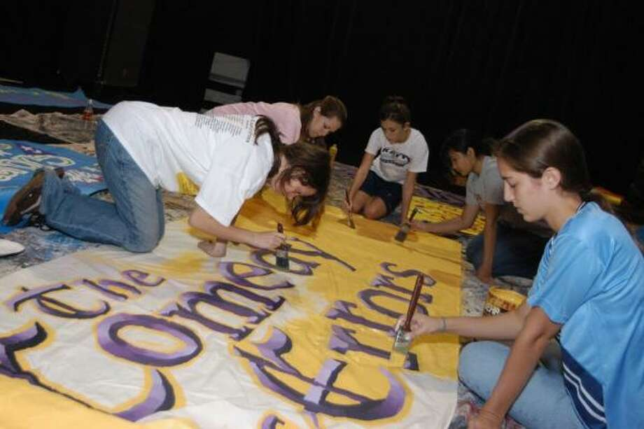Cinco Ranch High Theater Company publicity crew members, from left, Rachel Reed, Emily Macrander, Angelle Lambert, Paulina Abella and Sarah Dobson finish a piece of muslin to hang in the school. Photo: Robert Barreda, For The Chronicle