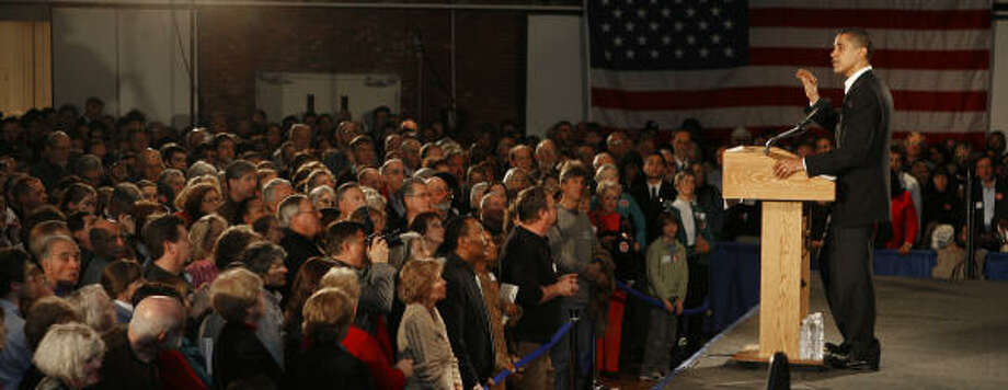 At a state Democratic election celebration party in Manchester, N.H., on Sunday, Barack Obama, D-Ill., answered questions about how his family, inexperience and even whether his middle name could affect his candidacy. Photo: JIM COLE, AP