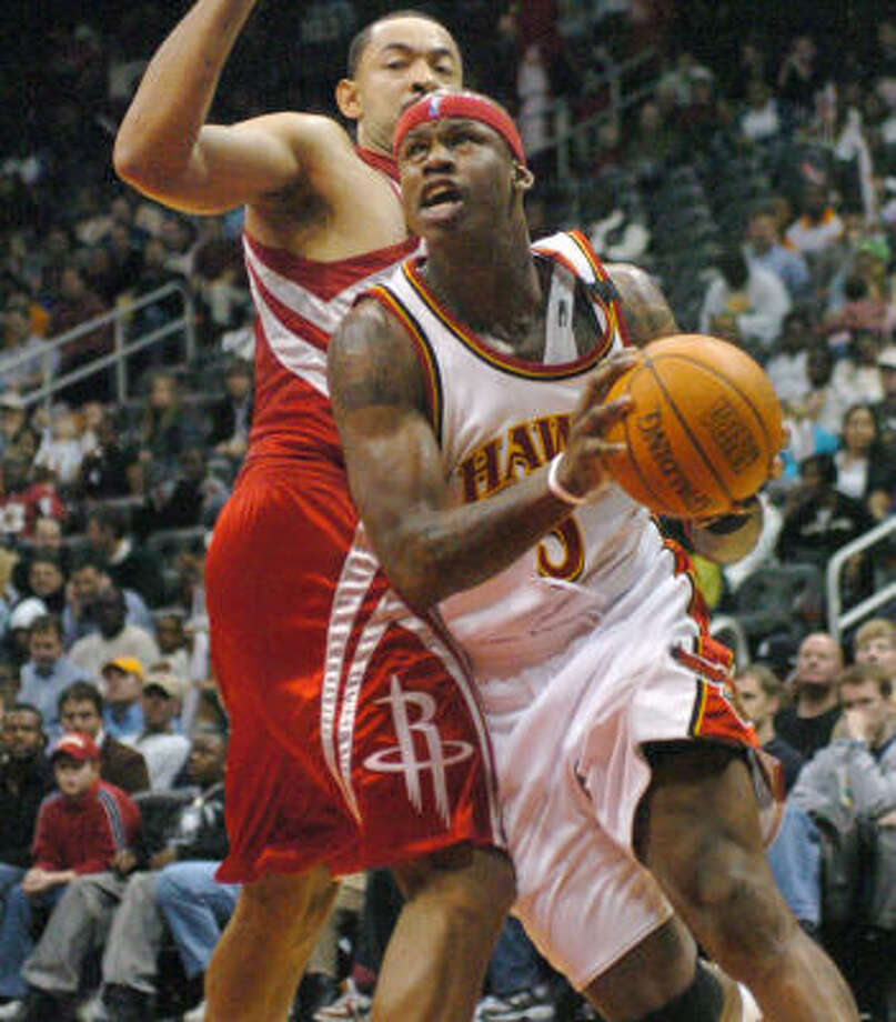 Atlanta Hawks forward Al Harrington (3) drives against Rockets forward Juwan Howard during a game last season. Photo: GREGORY SMITH, AP