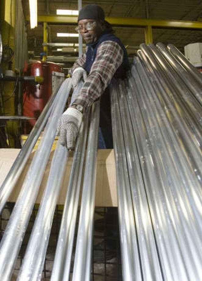 Phil Davis puts plastic over Festivus poles prior to shipping from the Wagner Cos. plant in Milwaukee. In 2005, the hand-railing component producer sold 250 poles, inspired by a Seinfeld episode, and expects to sell 600 this year. Photo: Morry Gash, AP
