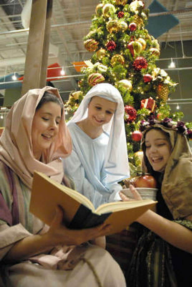 "At The Woodlands United Methodist Church, Julie Phalen, from left, Kristina Seeber, 11, and Maddie George, 11, play townspeople in the church's ""Christmas in Bethlehem"" program. Photo: Meenu Bhardwaj, For The Chronicle"