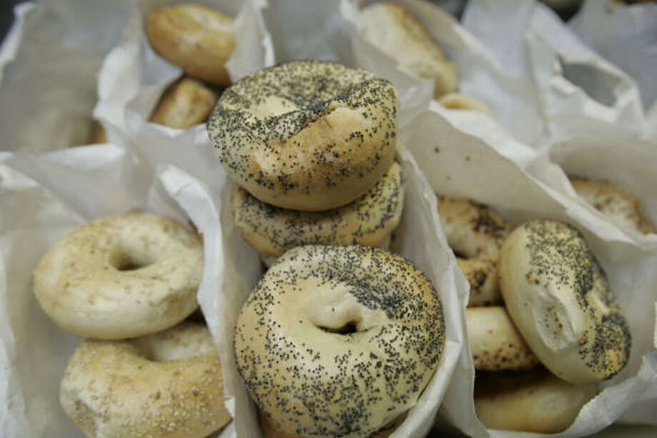 People can't resist bagels at New York Bagel and Coffee Shop. Photo: Nathan Lindstrom, For The Chronicle