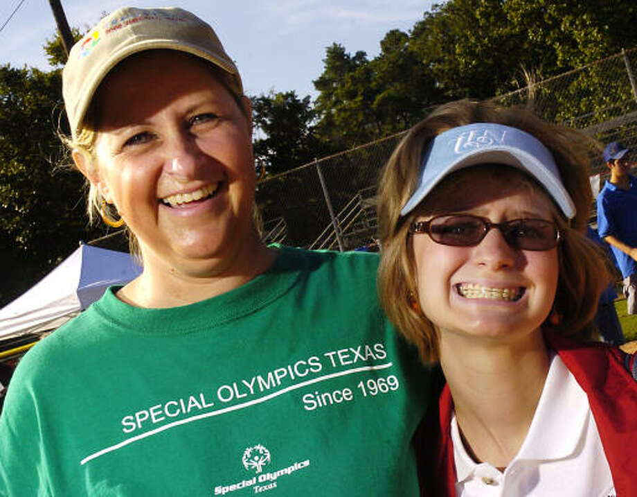 Hiillary Kern with her mother, Barbara, before the start of a bocce tournament in Memorial Park on Oct. 7. Photo: Dave Rossman, For The Chronicle