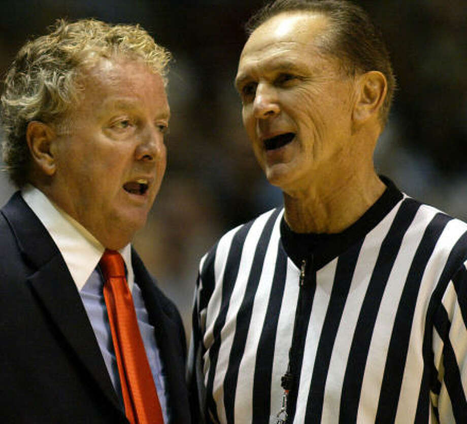 UH coach Tom Penders talks to referee Bob Donato during the opener against Rhode Island. Photo: JOE GIBLIN, AP