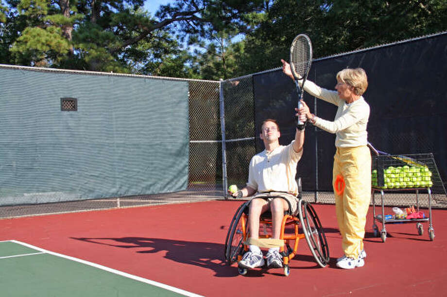 Tennis teaching pro Christie Borne has made it her mission to teach wheelchair-bound players, like 24-year-old Brandon Ivey. Photo: Tom Behrens, For The Chronicle
