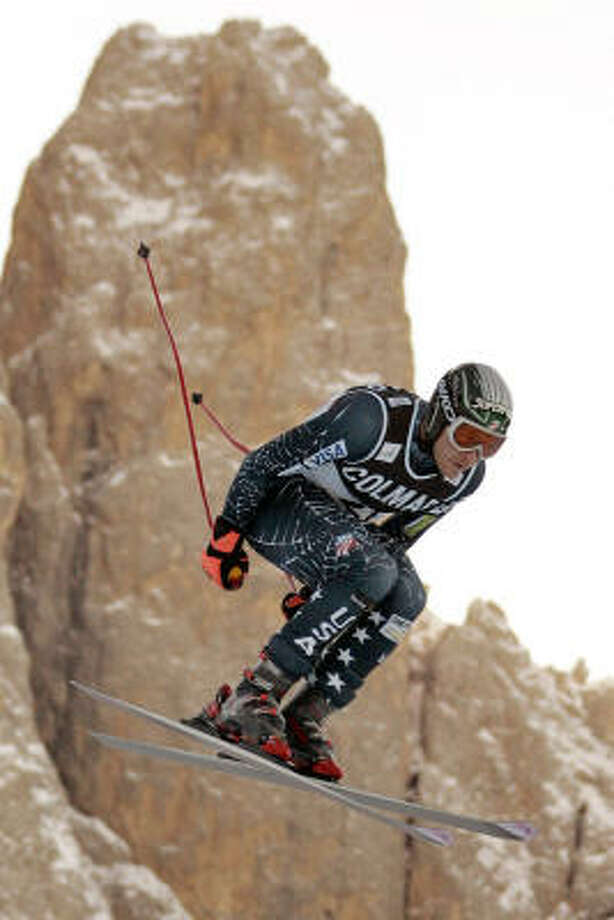 U.S. skier Bode Miller catches some air on Saslong Mountain on Thursday as he practices for Saturday's World Cup downhill at Val Gardena, Italy, where he never has finished in the top three. Photo: FABRICE COFFRINI, AFP/Getty Images