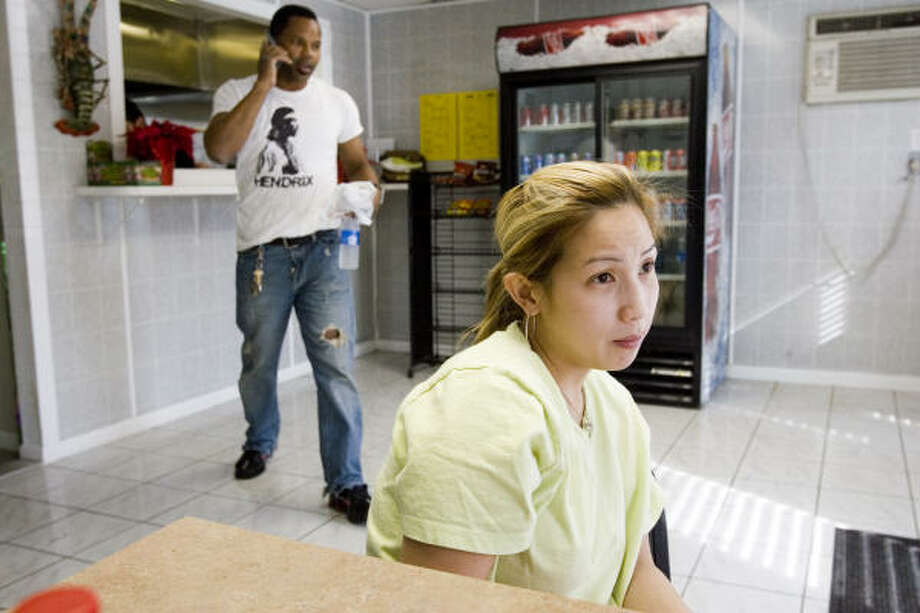 "Hurricane Katrina evacuee Beth Nguyen, 29, has opened a small sandwich shop with her fiance, Wayne Tran, and plans to stay in Houston. ""I can't go anywhere now,"" she said, ""because this is my business."" Photo: BRETT COOMER, CHRONICLE"