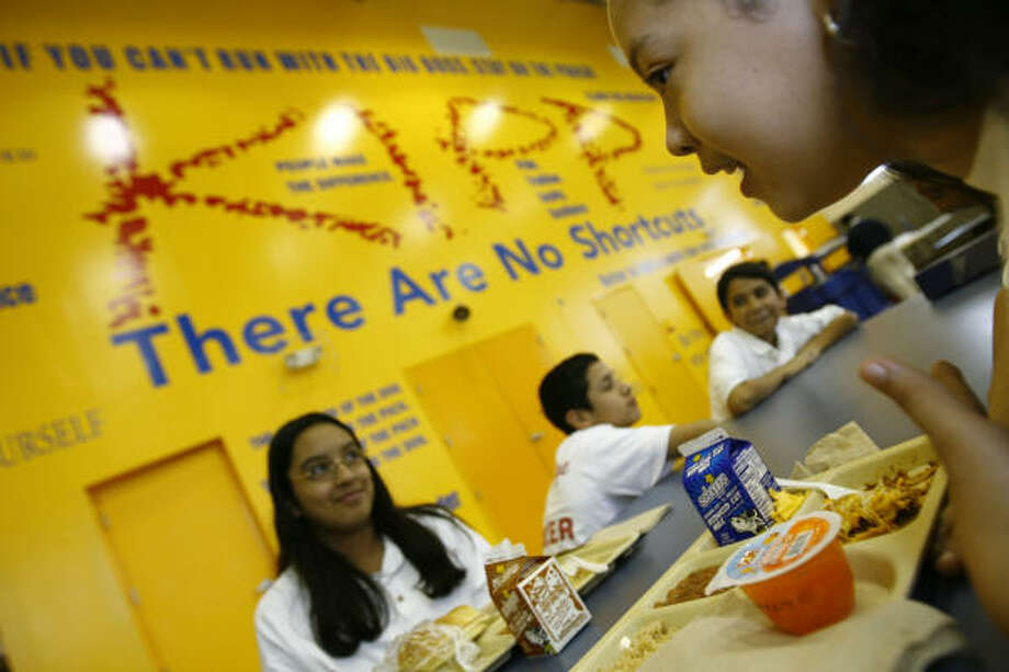 Fifth-grader Janie Cruz, right, says teachers at the KIPP Academy Middle School in southwest Houston treat her as a young adult and life class teaches lessons that apply to her life outside school. Photo: Nick De La Torre, CHRONICLE