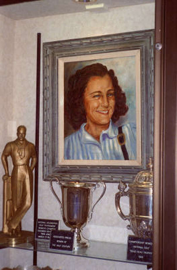 "Mildred ""Babe"" Didrikson Zaharias' portrait and many of her awards, including Olympic medals, are displayed in a Beaumont museum. Photo: Mitchell Rappaport, Special To The Chronicle"