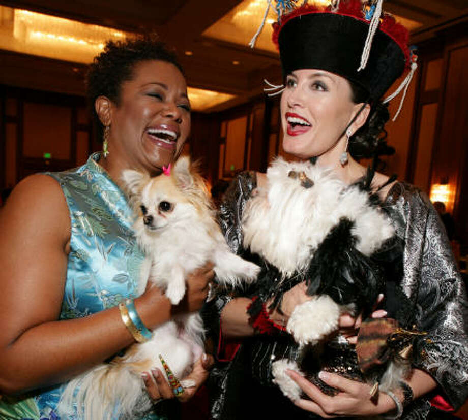 Debra Duncan, left, and Kimberly DeLape chaired the Citizens for Animal Protection 15th annual Mr. Magoo birthday party at the J.W. Marriott. Photo: Jill Hunter, For The Chronicle