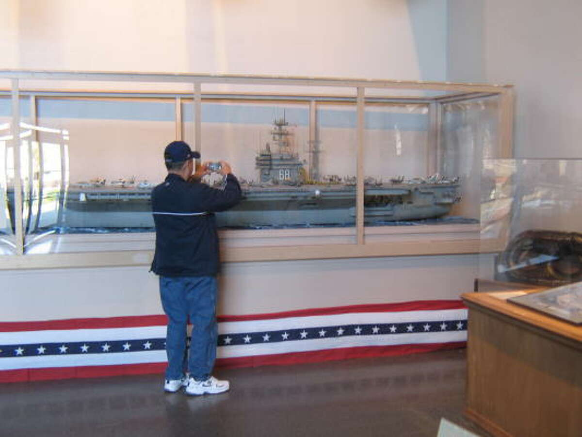 A visitor takes in a large model of the USS Nimitz aircraft carrier on display at the National Museum of the Pacific War. The state's $9 million bond issue will help finish the museum itself. The site's entire makeover, costing more than $16 million, is due for completion in late 2009.