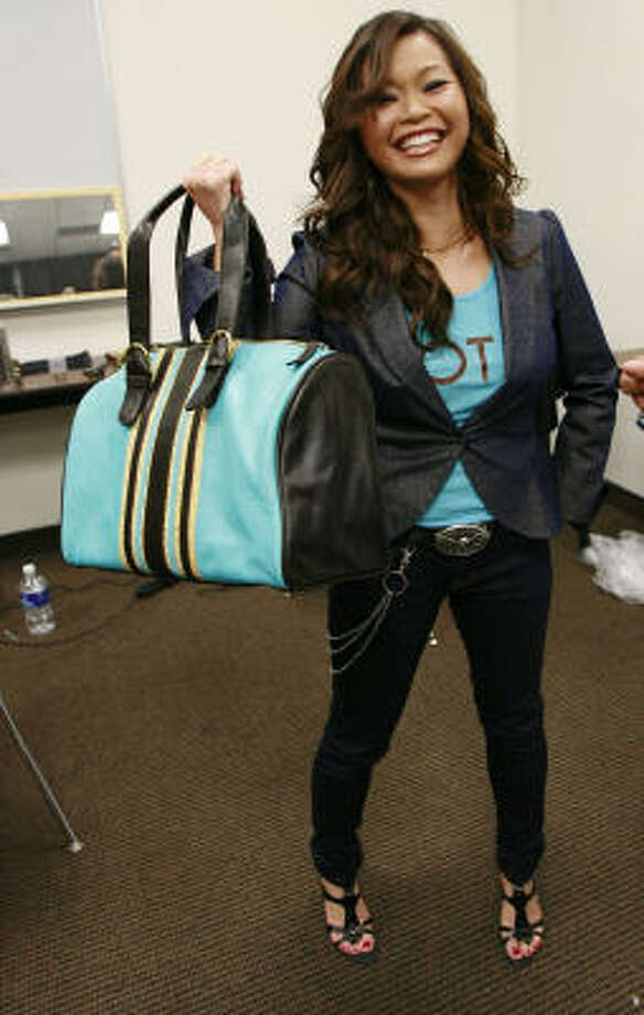 Clothing designer Chloe Dao shows off her ''Chloe Bag,'' $595 in leather and $95 in canvas at www.bravotv.com/projectrunway.com. Photo: James Nielsen, Chronicle
