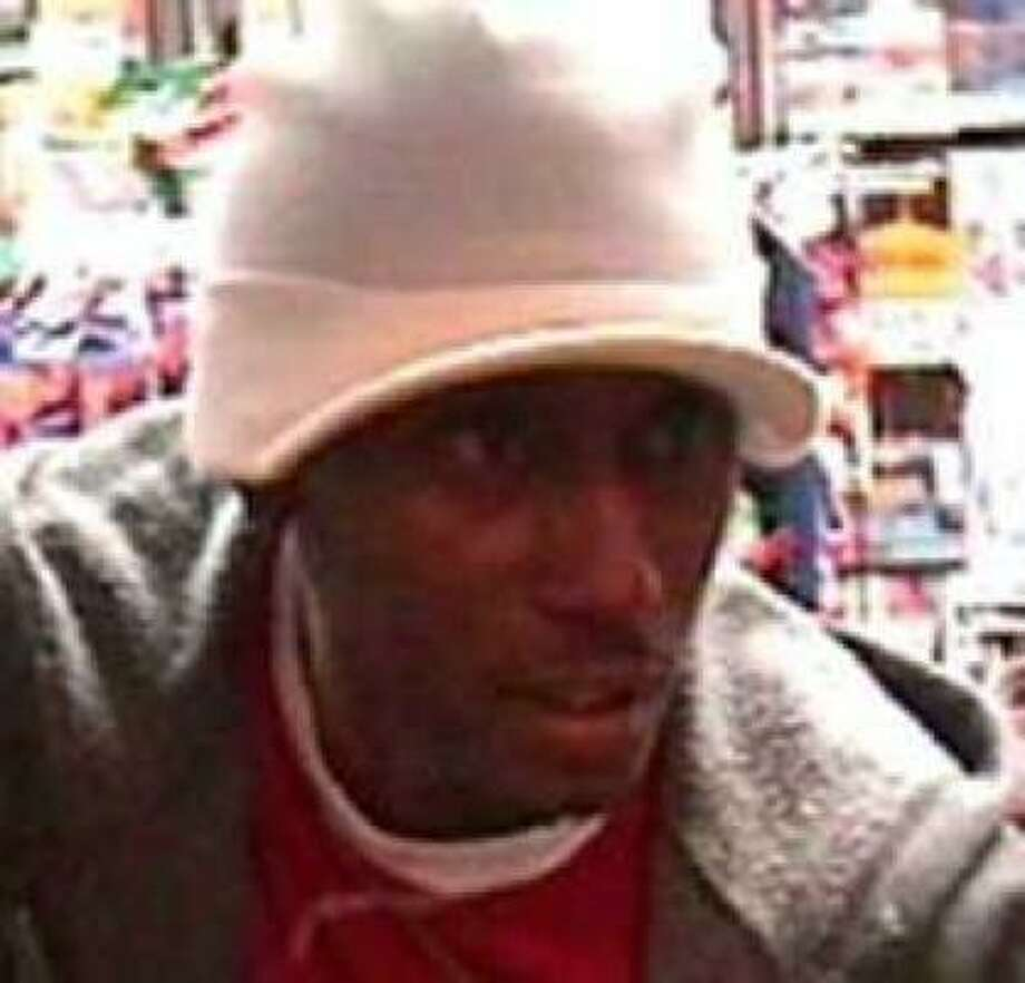 Houston Police Department released this image of a suspect believed to be responsible for robbing up to 30 stores across the area. Photo: HPD