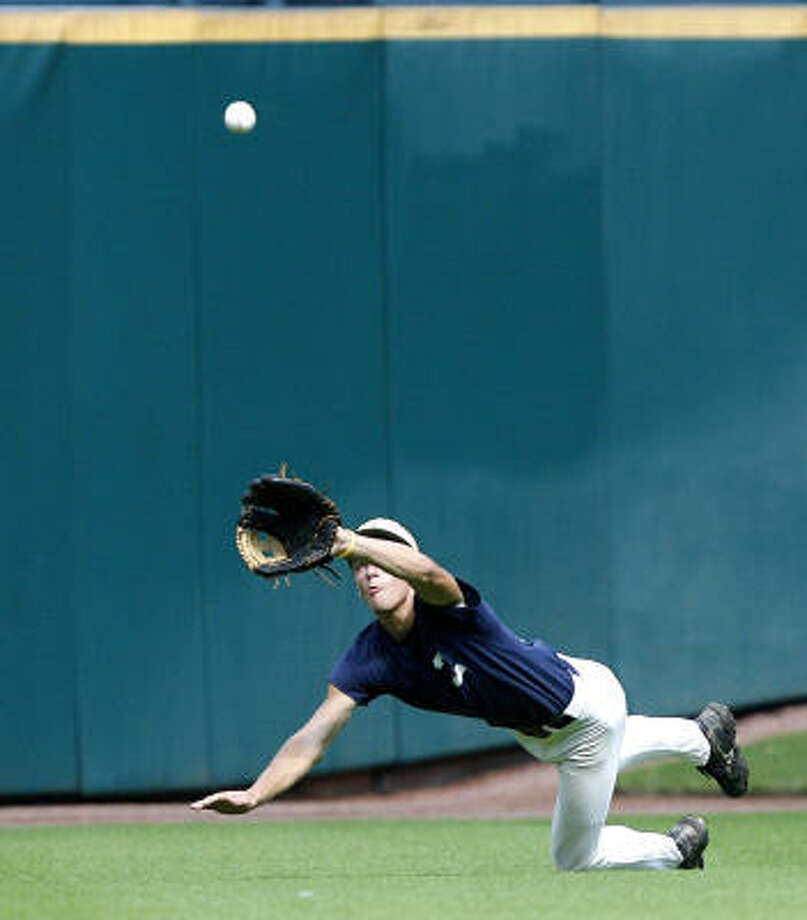 Klein Collins center fielder Josh Bates makes a catch in front of Tal's Hill. Photo: Bob Levey, For The Chronicle