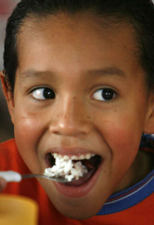 Hector Hernandez, 7, eats rice and beans at his home at the Aldea Infantil SOS orphanage outside Tegucigalpa, Honduras, in late August. Photo: SharÓn Steinmann, Chronicle
