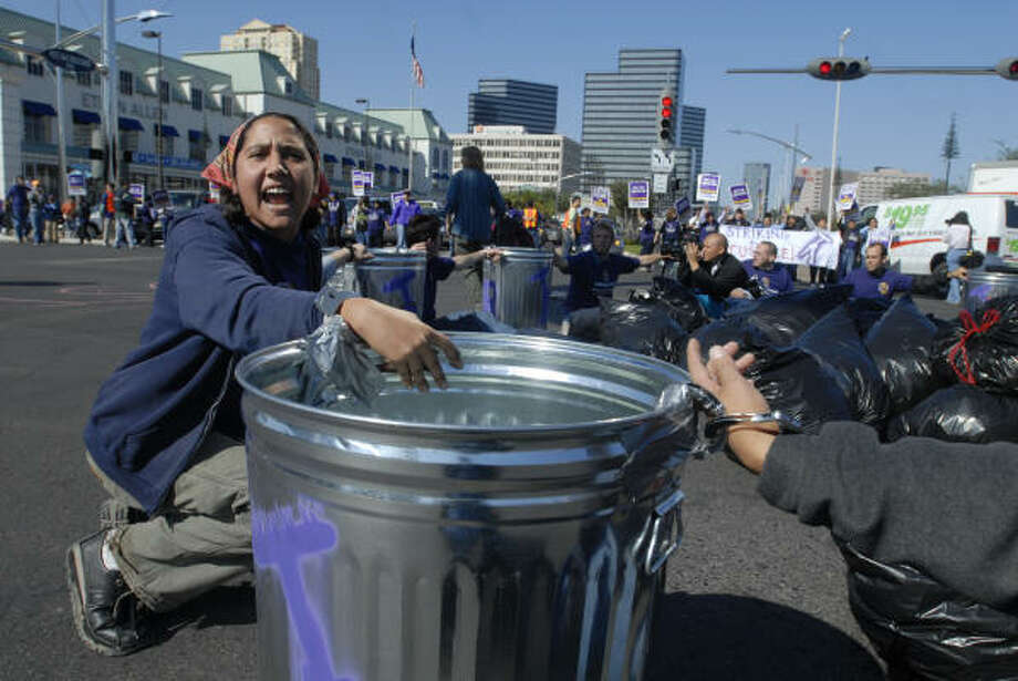 About a dozen supporters of striking Houston janitors were arrested today after a larger group blocked the intersection of Westheimer and Post Oak in Houston. Photo: Carlos Javier Sanchez, Houston Chronicle