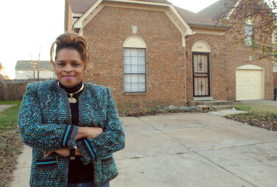 Jean Phillips, a member of the Temple of Deliverance Church of God in Christ in Memphis, Tenn., on Tuesday shows the house that was donated to a displaced couple, who sold it and went back to New Orleans. Photo: GREG CAMPBELL, AP