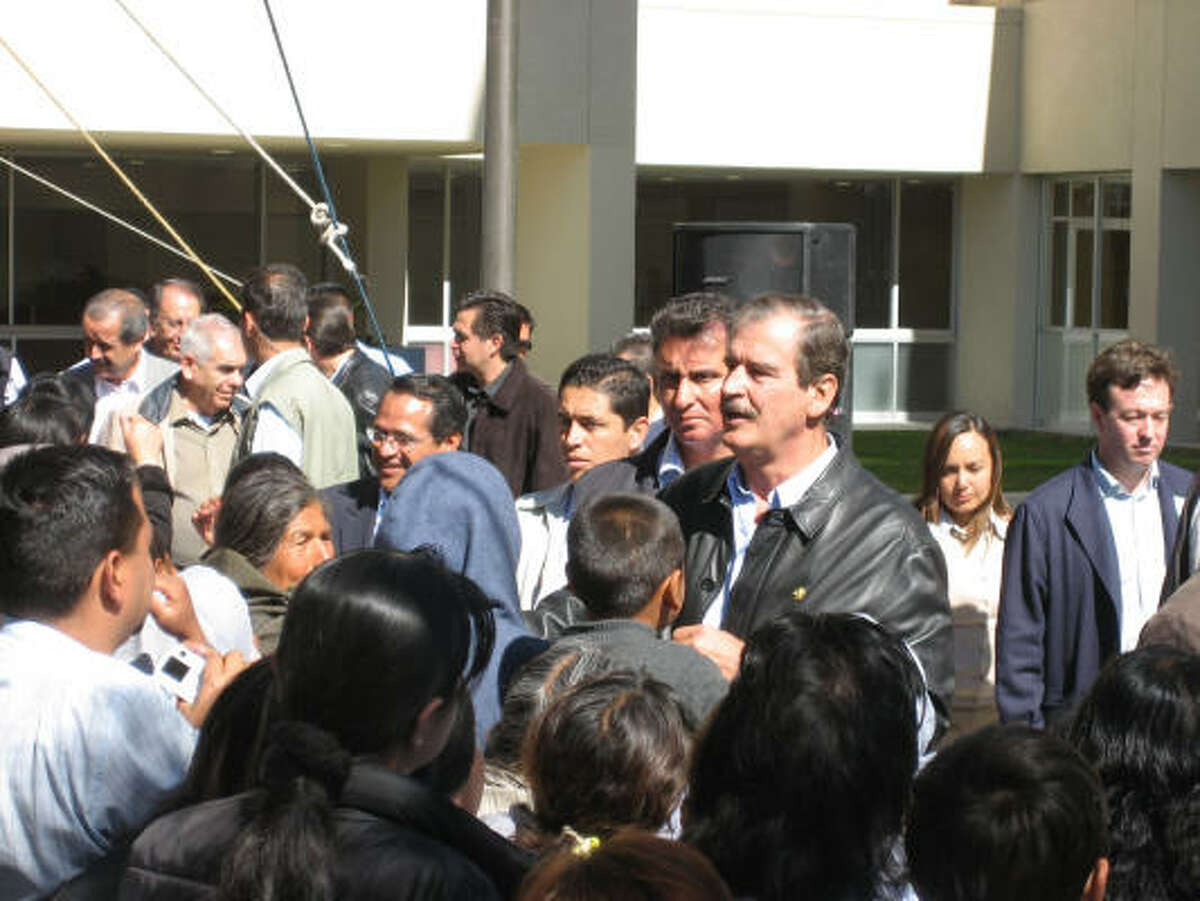 Vicente Fox greets supporters Thursday in Leon on the last day of his presidency.