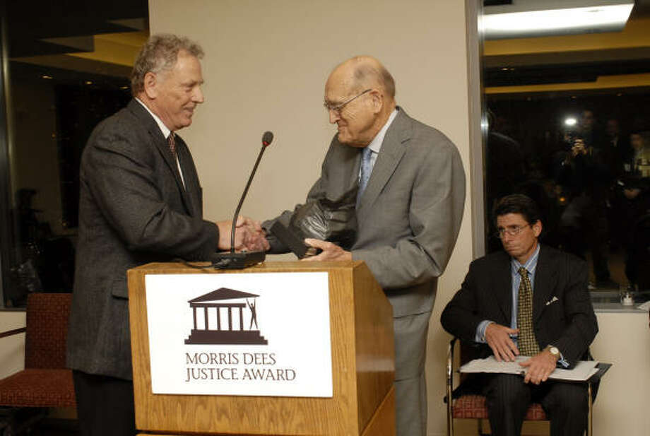 Morris Dees, co-founder of the Southern Poverty Law Center, presents an award named for him to U.S. District Judge William Wayne Justice on Nov. 16. Photo: University Of Alabama
