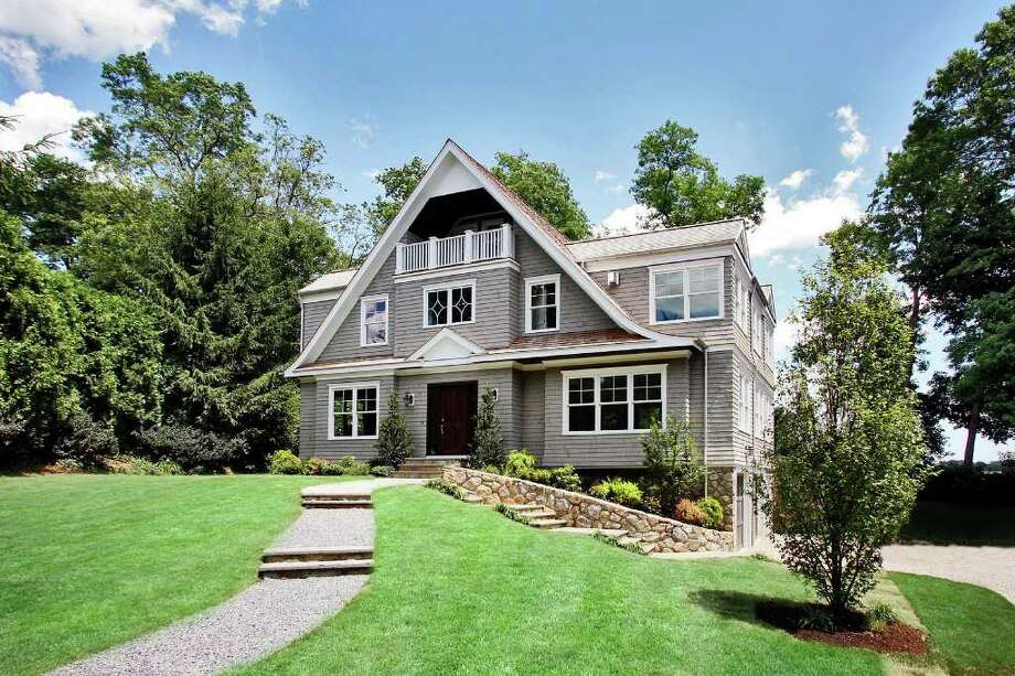 This newly-constructed stone and shingle colonial house on a quarter-acre lot near Compo Beach offers a two-car garage, a long driveway and views of Mill Pond and Long Island Sound. Photo: Contributed Photo