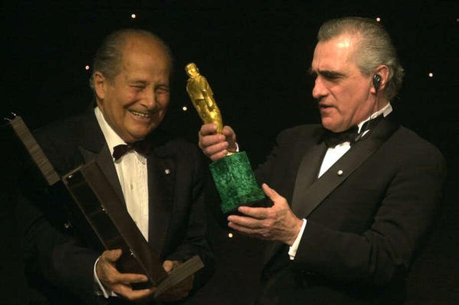 Martin Scorsese, right, receives an award from Italian film director Gillo Pontecorvo in 2001. Photo: CLAUDIA GAZZINI, Associated Press