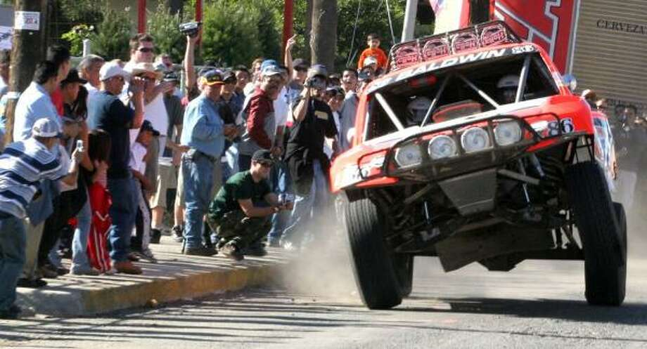 If you don't want to participate in the Baja 1000 race, shown here, you can spend a week driving the course. Photo: REUTERS
