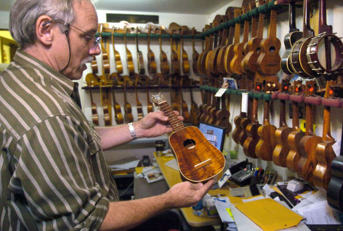 Bart Wittrock, general manager of Rockin' Robin Guitars and Music, owns more than 200 ukeleles.