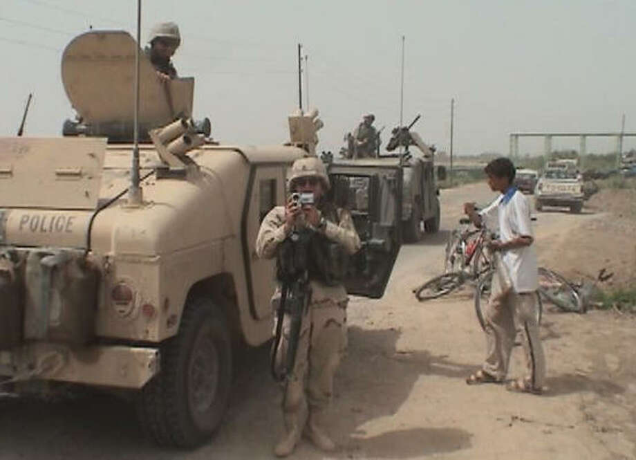 Sgt. Stephen Pink chronicles the Iraq War with a video camera in The War Tapes. Photo: Senart Films