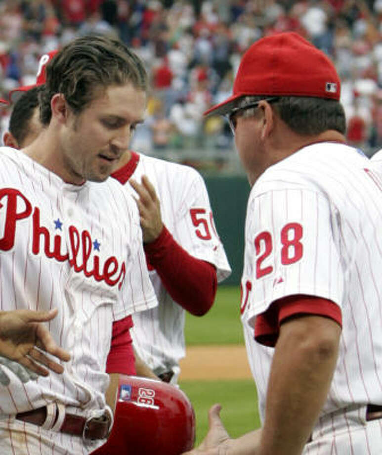 Chase Utley, left, won Monday's game with a homer in extra innings. Photo: RUSTY KENNEDY, AP
